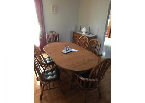 Oak dinner table with chairs and server